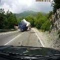 Truck Tips Over Slides Headlong Into Oncoming Car