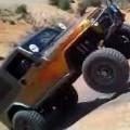 Jeep Climbs Up A Steep Rock