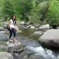 Girl Fails At Jumping Creek