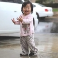 Toddler Playing In The Rain For First Time