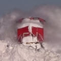 Train Slams Through Giant Snow Drifts