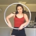 Girl Performs Hypnotizing Dance with Hula Hoop