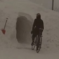 Riding Bikes Through Giant Snow Tunnel
