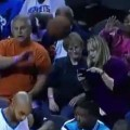 Distracted Fan Gets Hit In The Face By Basketball