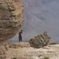 Man tempts fate by running along cliff edge