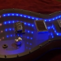 Guy builds unbelievable infinity mirror guitar