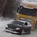 Audi pulls truck up snowy hill