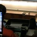 College kid takes lecture notes with a typewriter