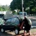 Buff Biker Lifts Car Off of Bike Path