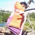 Girl picks up giant snake like it's no big deal
