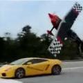 Stunt Plane Races Lamborghini